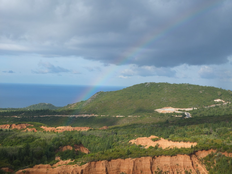 Rainbow over the spectacular rock formation of Gjipe